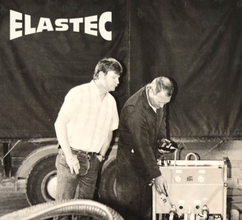 Donnie Wilson and Jeff Cantrell with early Elastec oil skimmer