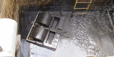 Skimming oil in industrial pit banner